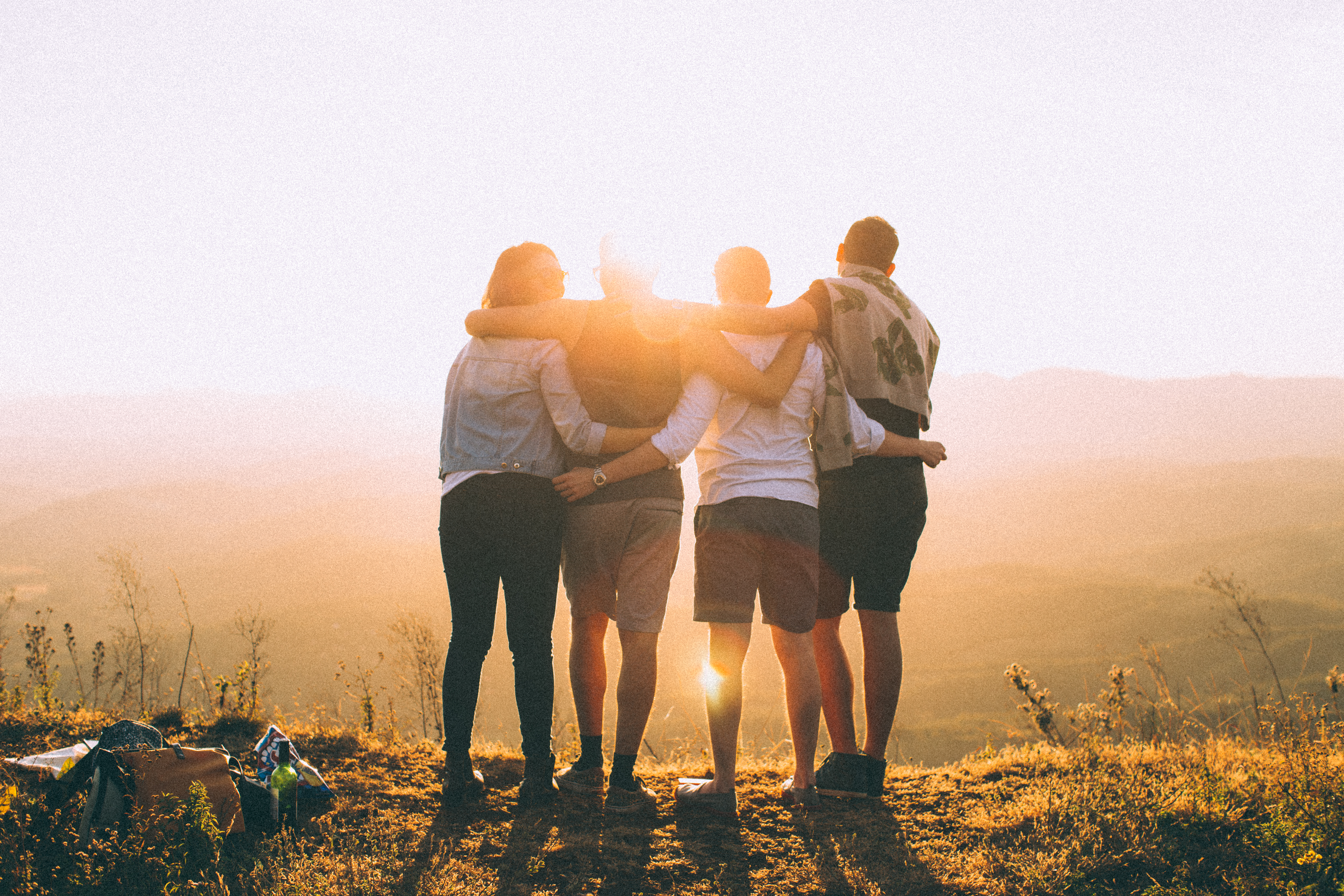 Canva Four Person Standing on Cliff in Front of Sun - Why we value community at SVA